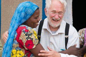 Lytton hugging Rwandan woman